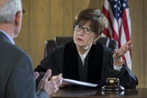 Bail bondsman talking to a judge