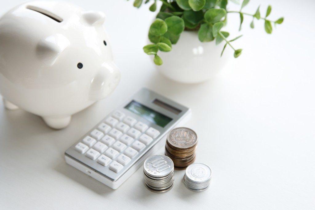 coins, calculator, and piggy bank