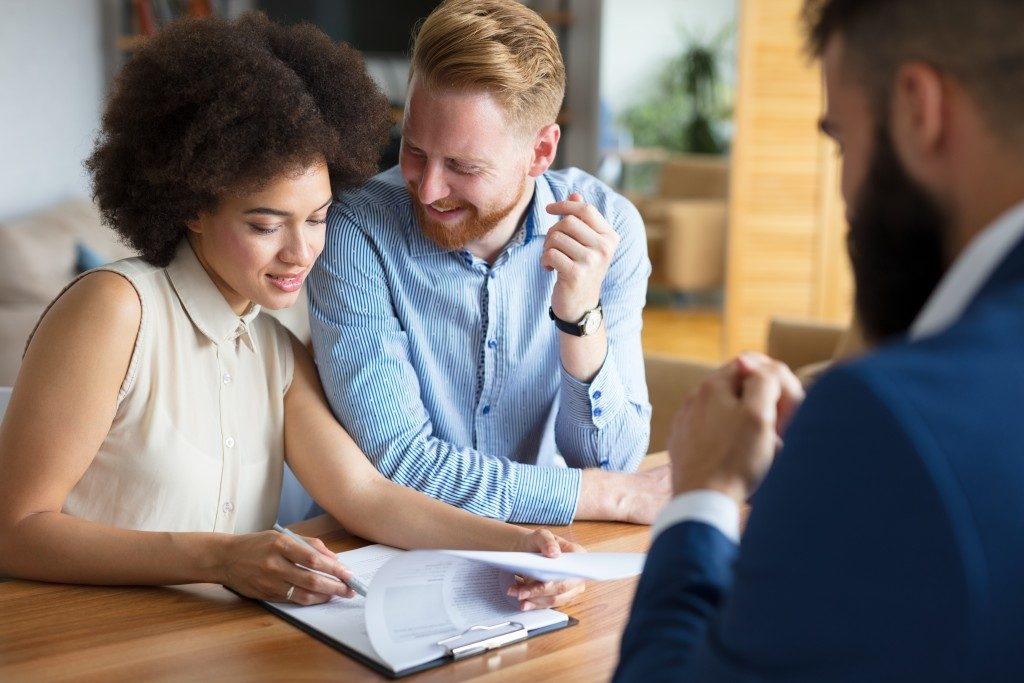 Couple consulting agent about a property