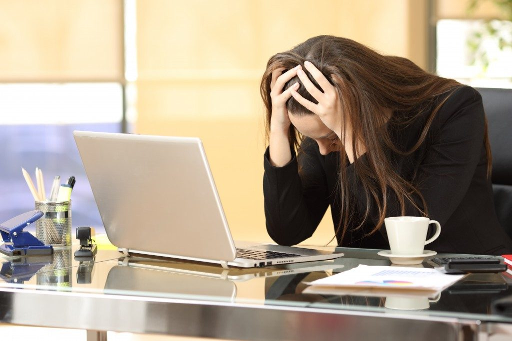 Woman emotionally stressed about the bankruptcy