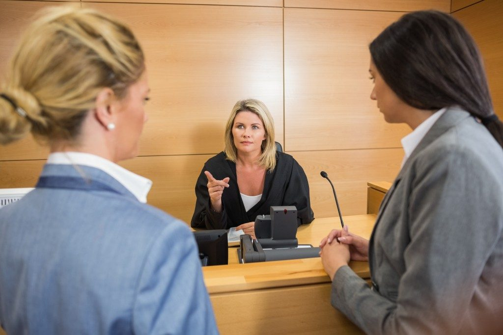 Female judge talking to lawyers