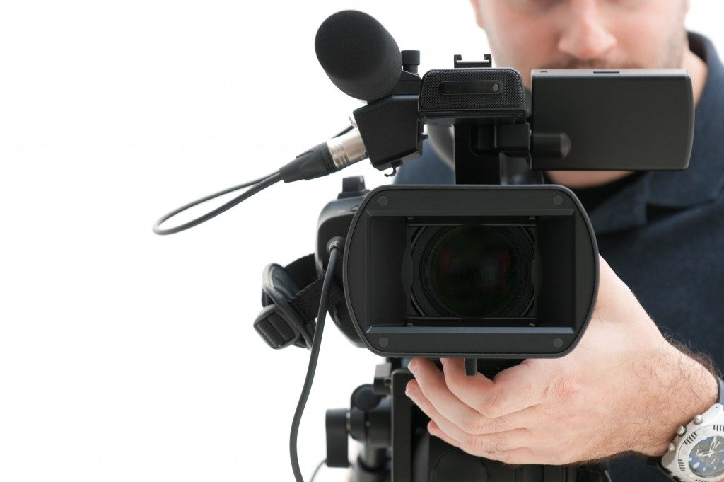 Court reporter using a video camera