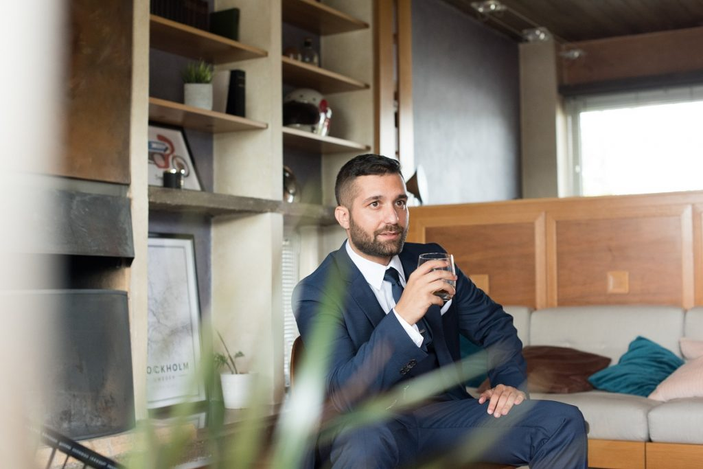 Man in corporate attire holding a cup of coffee
