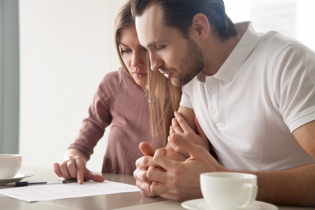 Couple reading through a mortgage form