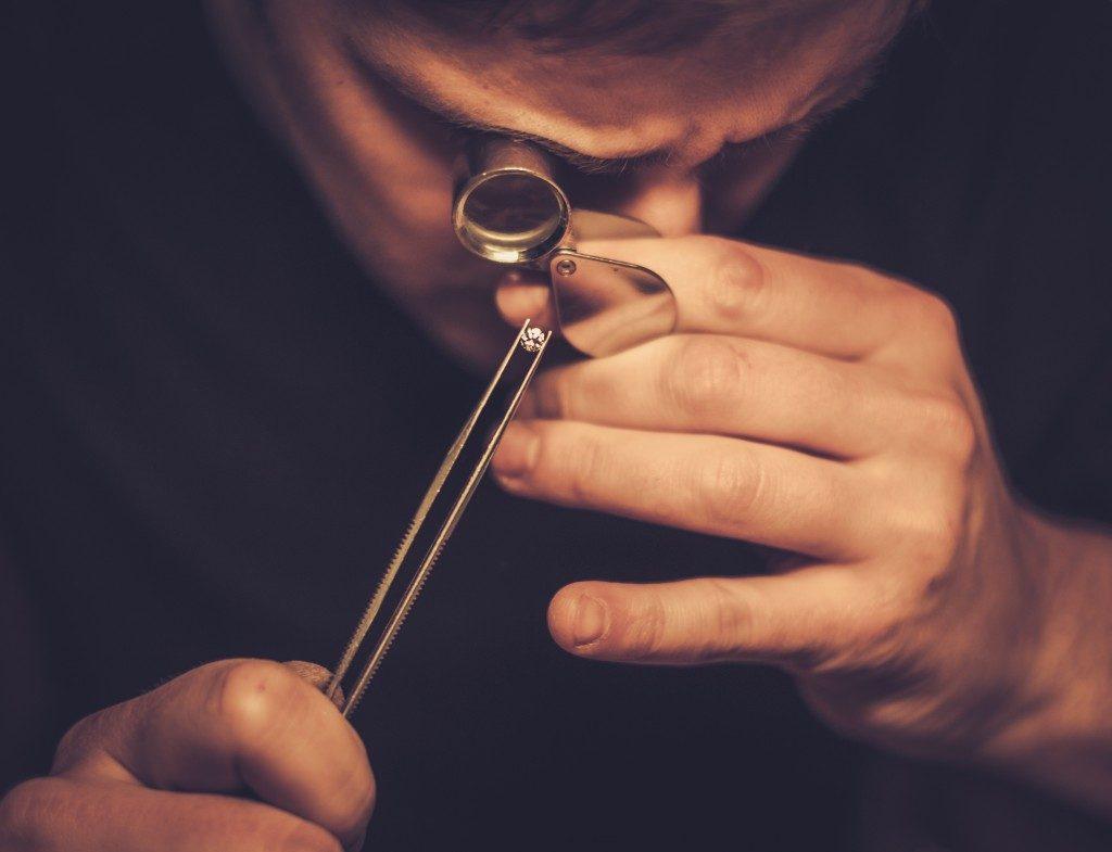 Jeweler evaluating jewelry