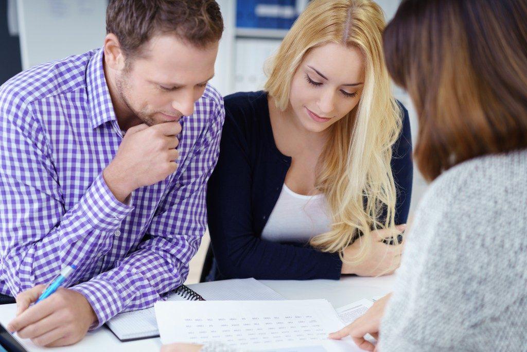 FInancial advisor explaining mortgage details to couple