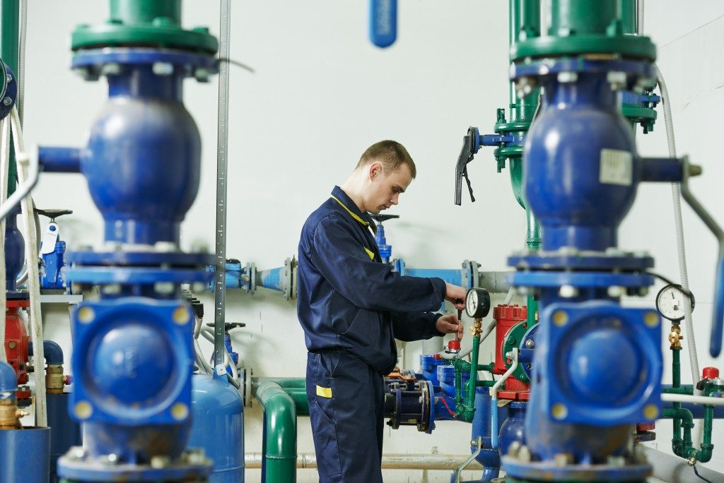 maintenance man checking pump