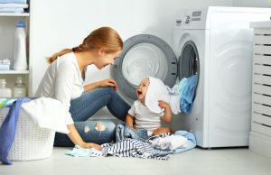 Mother and toddler laundry