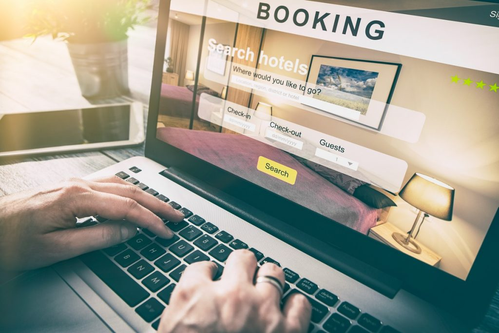 person booking a hotel on a website