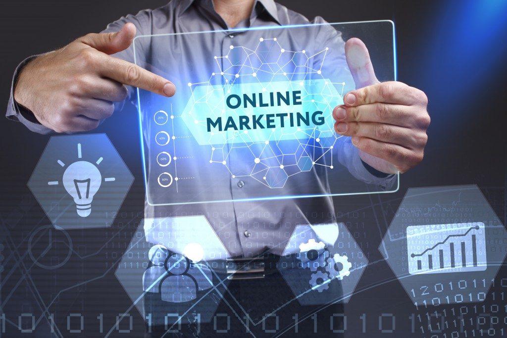 man holding online marketing virtual board