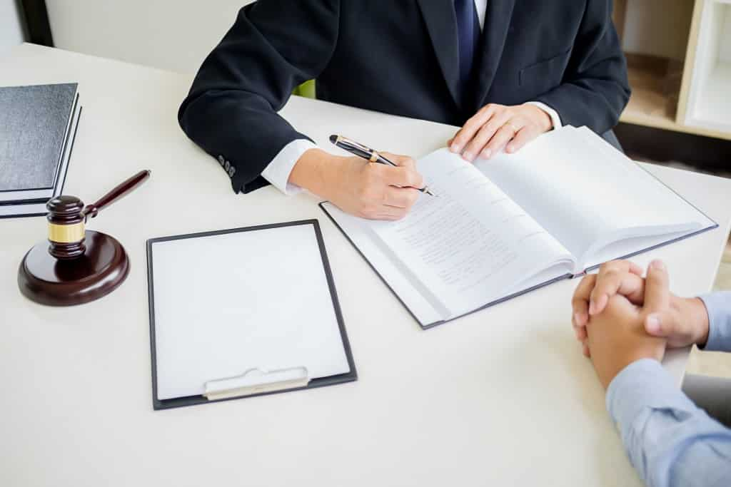 lawyer writing infront of client