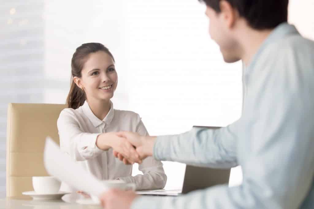 hr person shaking hands with an applicant