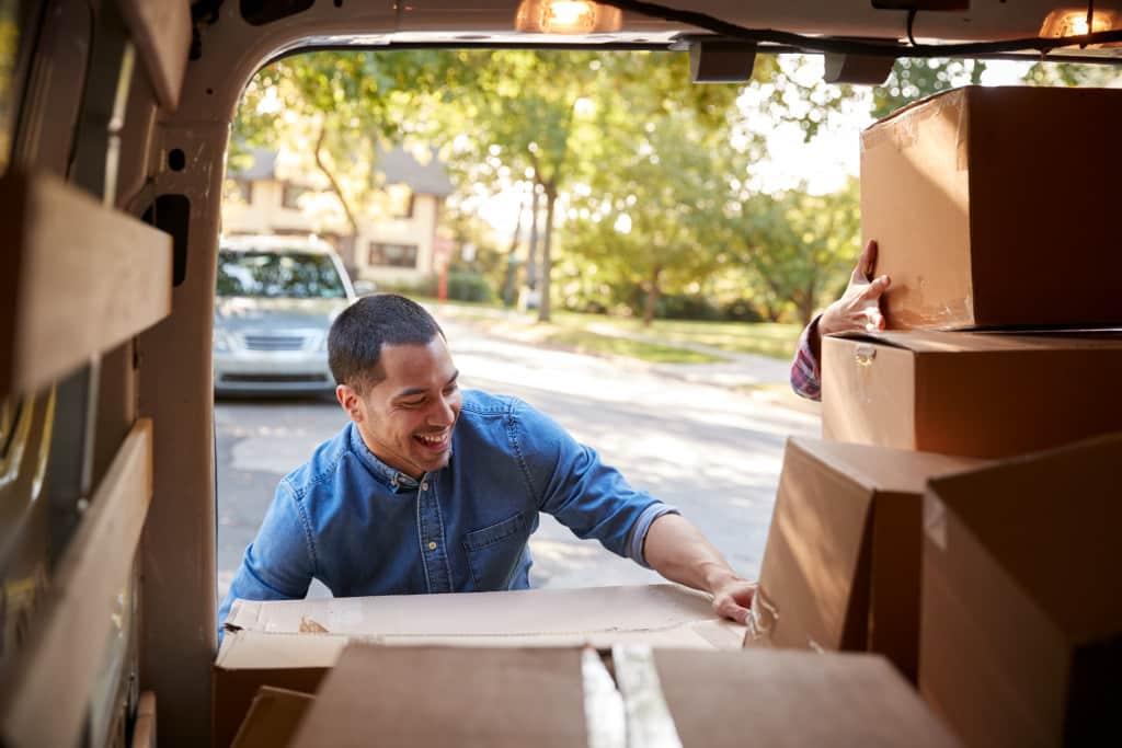 Guy unloading a box