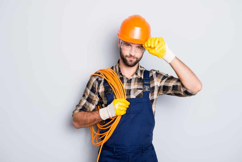 Electrician holding cable wires