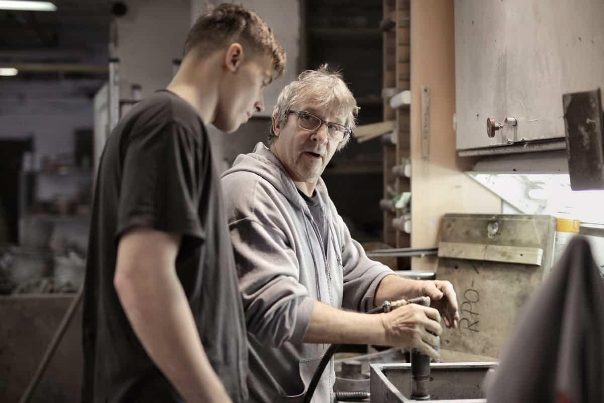 2 men talking workshop